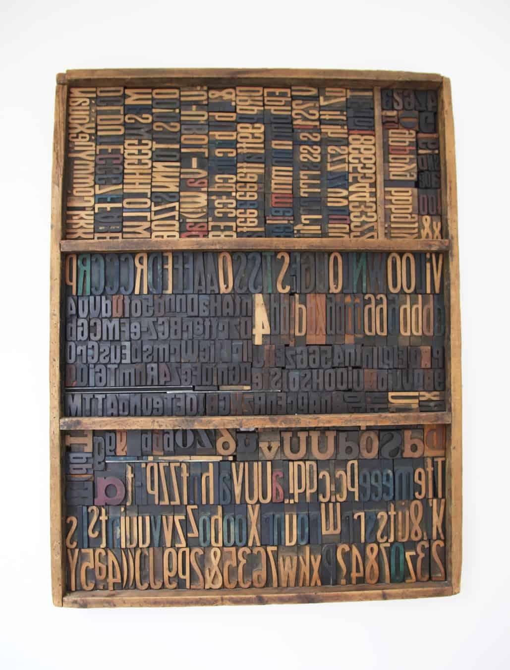 Scomparti per caratteri tipografici in legno. Tipografia Unione, Vicenza, museo.